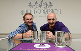 David-Louis Hendley of Artful Expressions and Mark Pressdee Macoy of Two Towers enjoying a craft ale from their official tankards created especially for their Fusion event.